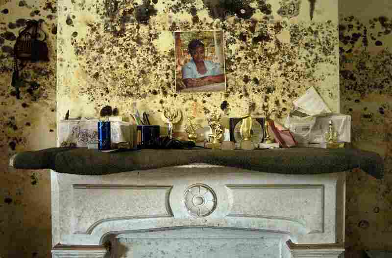 The mantle over the Robinson household in the ninth ward on Burgundy street shows the effects of the flood water on Oct. 12, 2005. There was little to save from the house that took over six feet of water from Hurricane Katrina.