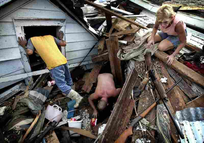 Residents dig through the rubble of what is left of their home in Biloxi, Miss, on Aug. 31, 2005, following Hurricane Katrina.