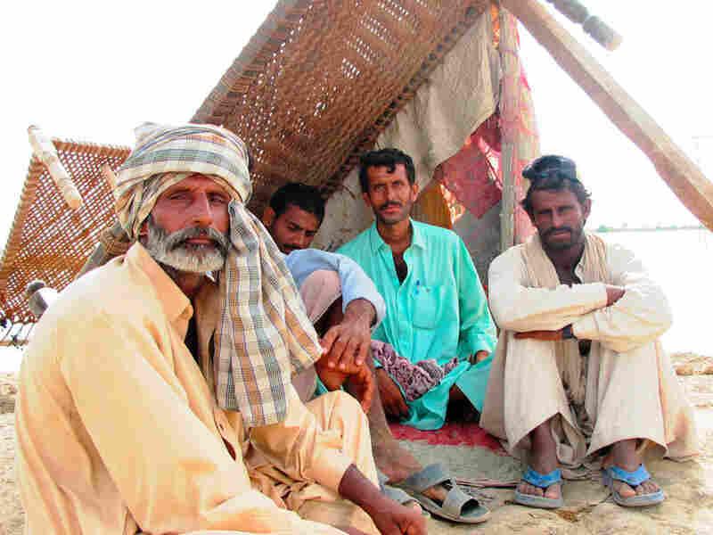 Zurif Kar, Hafiz Ullah, Abdul Majid and Sherun Kardarbush take shelter on top of the levee.