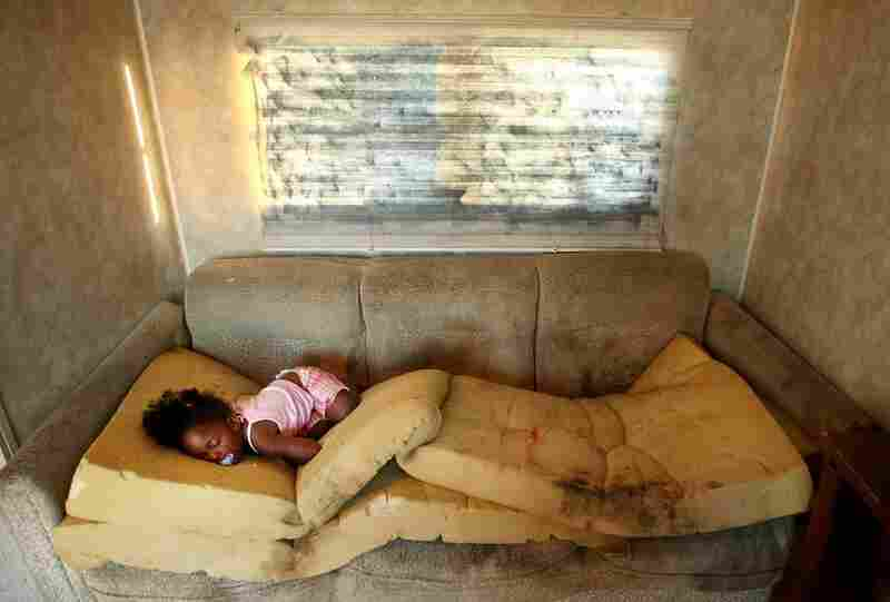 Kailah Smith, 18 months, sleeps on a moldy couch caused by rain leaks in her parents' trailer in the FEMA Diamond trailer park just before the family moved to an apartment May 28, 2008, in Port Sulphur, La. Smith's parents had to hospitalize her four times with bronchitis since moving into the trailer, and say they are sure the trailer was to blame for her illnesses.