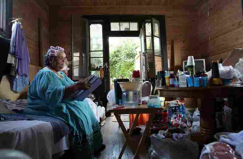 Retired seamstress Rita Gillett, 63, sits in her damaged home in the Lower Ninth Ward, where she lives with her husband Hazzert, on Aug. 24, 2007. The couple still lived without electricity or gas because they hadn't been able to secure government assistance to pay for the repairs.