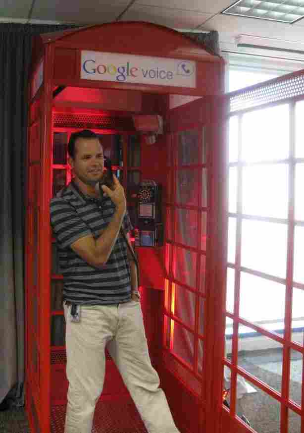 A man talks on a gmail phone