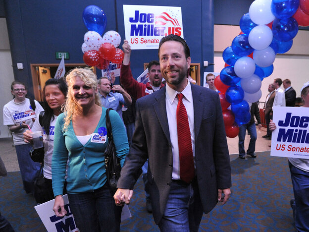 GOP senate candidate Joe Miller and his wife Kathleen in Anchorage, Aug. 24, 2010.