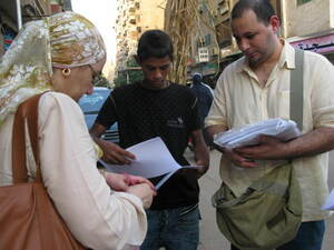 Ahmed Nasser (right) and Shahinaz Abdel-Wahab hand out petitions for better governance in Cairo.