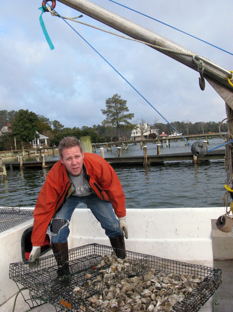 Ryan Croxton's grandfather's oyster operation dragged dredges across oyster reefs, ripping up the habitat. Croxton grows oysters in cages for the half-shell market.