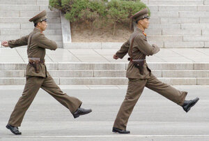 North Korean soldiers march at the DMZ