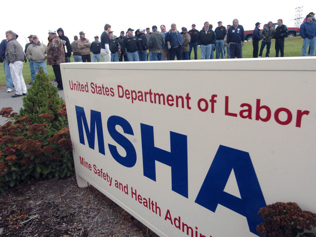 Miners from Pennsylvania and West Virginia outside the Mine Safety and Health Administration's Morgantown, W.Va., office in October 2006 waiting to meet with officials to demand stronger mine-safety rules. (AP)