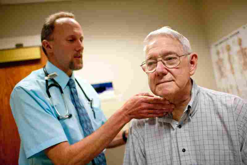 Martin's Point says this method is more efficient because patients are treated by team members they know. That translates to less stress for providers like Couper, pictured examining patient Carl Ditmars.