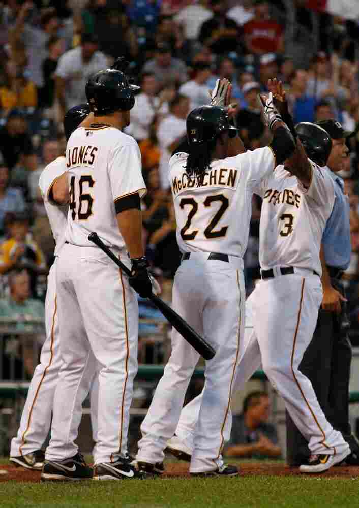 Pittsburgh Pirates players celebrate a play. Jared Wickerham/Getty Images