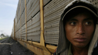 A migrant from Honduras waits for a train during his journey toward the U.S.-Mexico border on the outskirts of Mexico City.