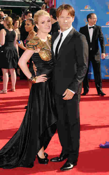 Actors Anna Paquin, left, and Stephen Moyer, from the HBO series True Blood, arrive at the Emmy Awards.