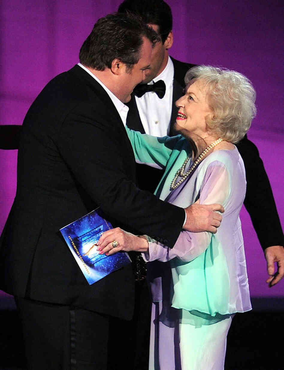 Actor Eric Stonestreet accepts the Outstanding Supporting Actor in a Comedy Series award for Modern Family from actress Betty White.
