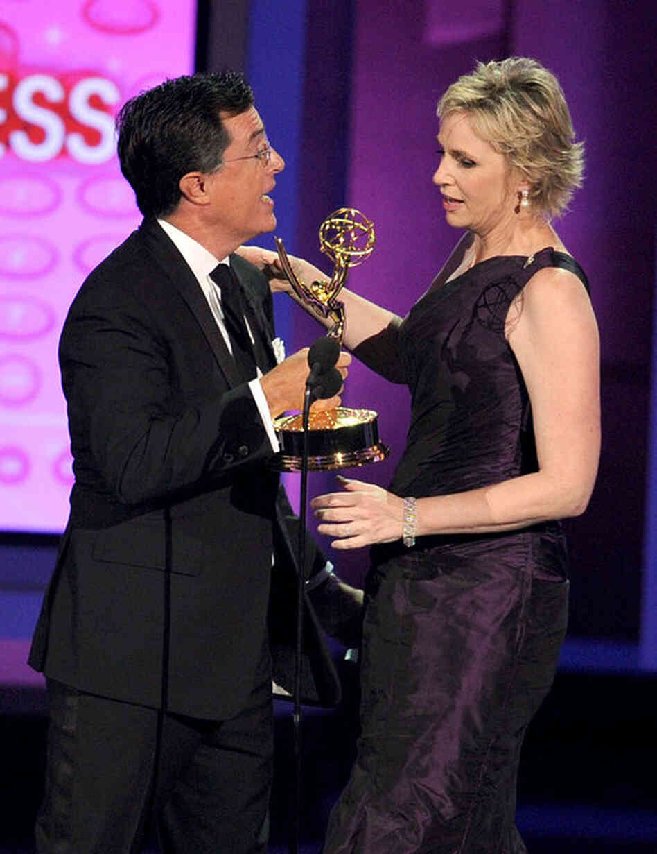 Actress Jane Lynch, right, accepts the Outstanding Supporting Actress in a Comedy Series award for Glee from Stephen Colbert.