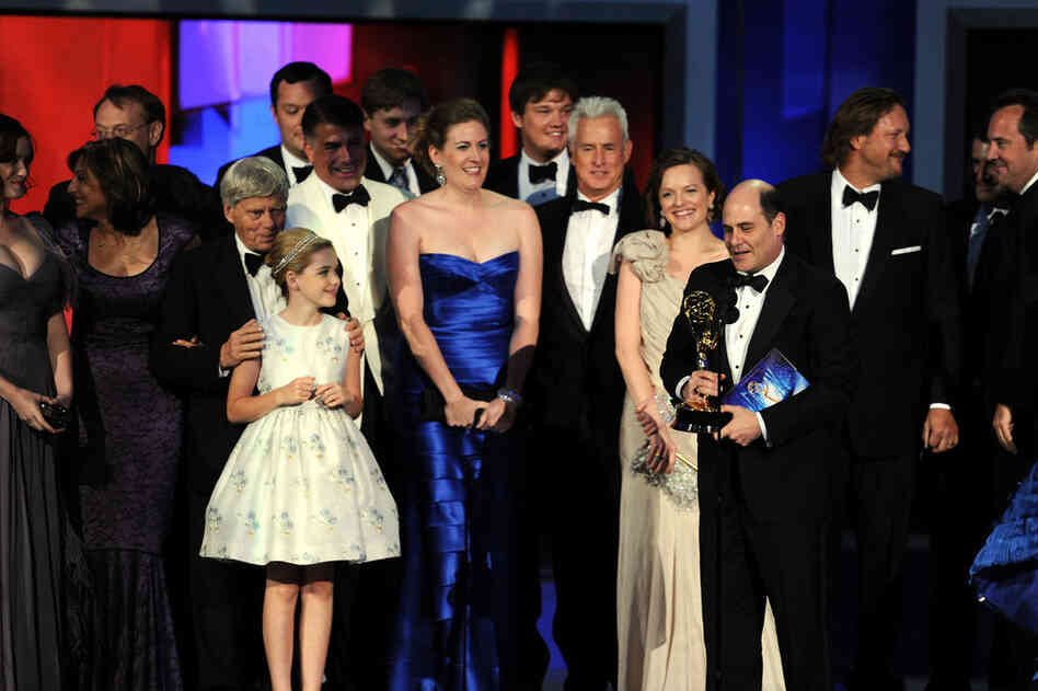 The cast of Mad Men accept the Outstanding Drama Series award onstage.
