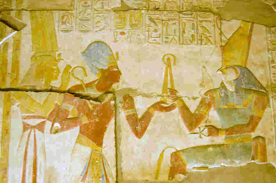 Ancient Egyptian Pharaoh Seti I with goddess Isis and god Horus.