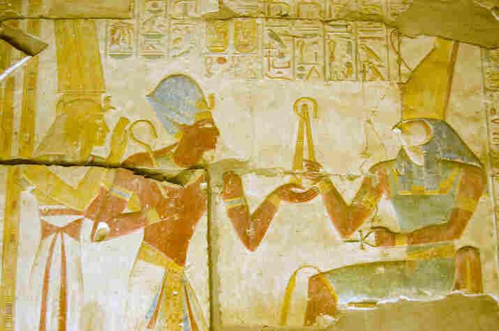 Ancient Egyptian Pharaoh Seti I with goddess Isis and god Horus.