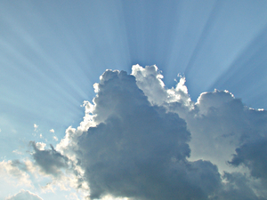 Sun rays from behind clouds.
