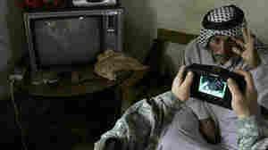 An Iraqi man stretches his eye as a US s