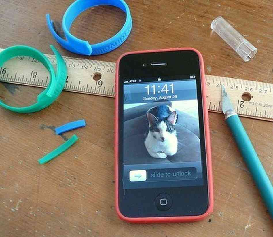 an iphone with a home-made bumper