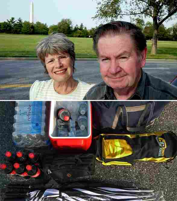 Diane Evans and W. Marshall Evans from Philadelphia and their trunk contents of water bottles, bags and umbrellas.