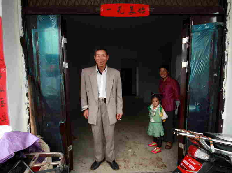"""""""I'm quite happy,"""" says Zhang Sihua about his new house. """"We will get used to it."""""""