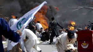 In Quetta, Sept. 3, people scramble to safety after a bomb attack.