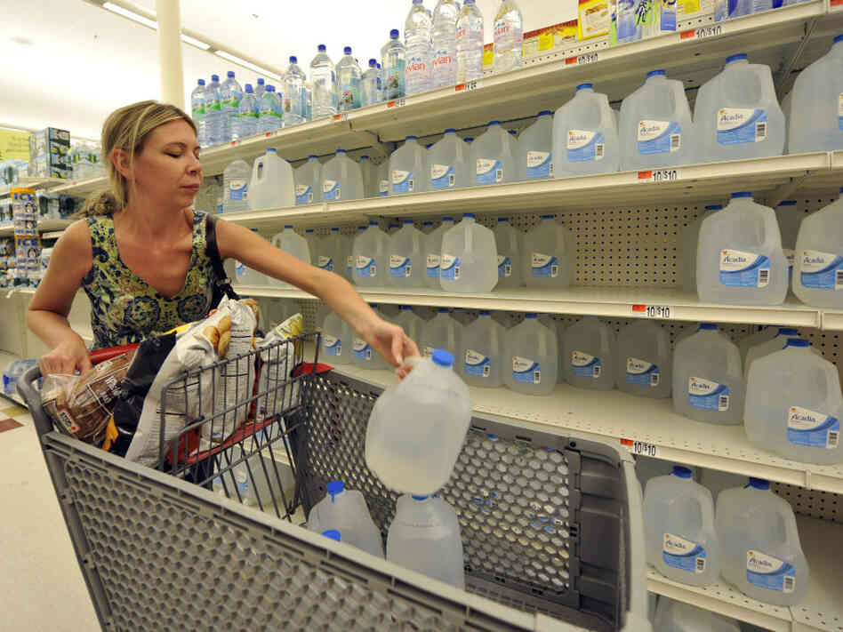 Kerry Hosek of Bay Shore, N.Y., stocks up on water in advance of Earl's arrival.
