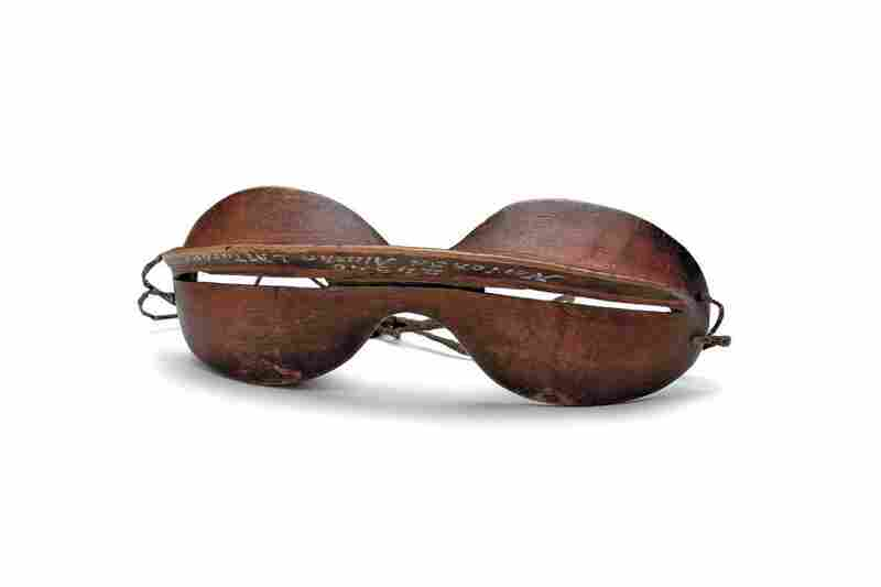 Inupiaq snow goggles. Ultraviolet light reflected from snow harms the retinas of the eyes, causing severe pain and temporary blindness. These elegant wooden goggles with narrow slits protected the eyes against sun and snow glare.