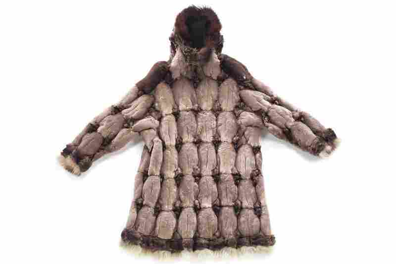 St. Lawrence Island Yupik bird-skin parka. This warm, lightweight parka is made from 85 crested auklet skins with a guillemot skin at each shoulder and dog-fur trim. St. Lawrence Island women made these parkas from the skins of auklets, ducks, cormorants, murres, loons and puffins.