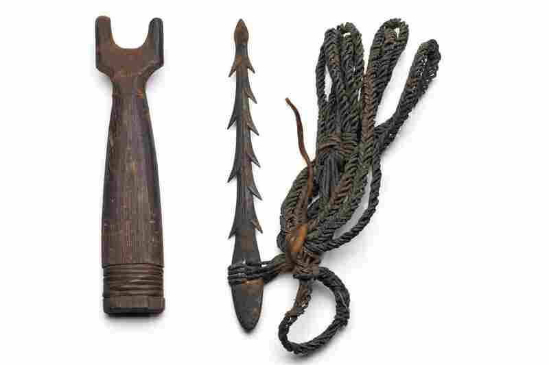 Haida harpoon head and cedar sheath. Harpoons were tipped with a point made of bone or iron. A plaited seaweed cord linked the harpoon head to the shaft.