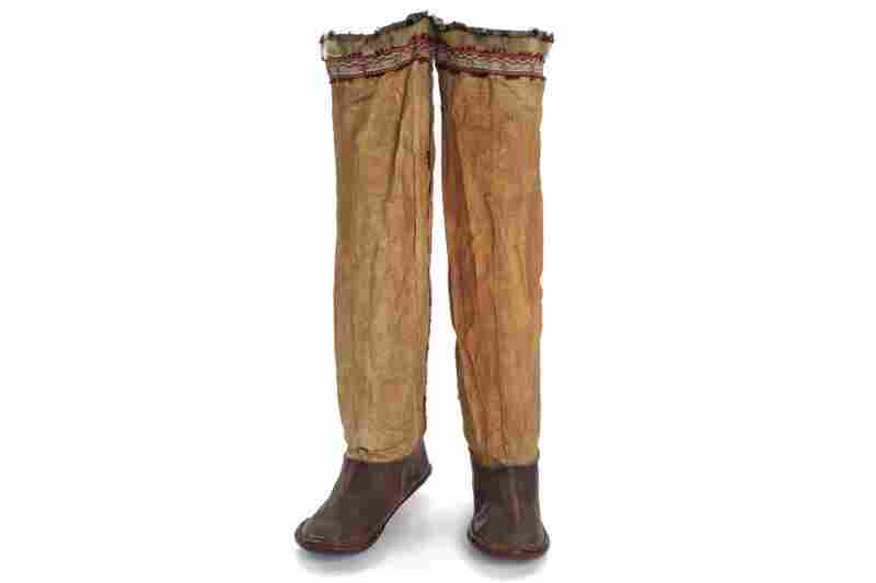 Unangax boots. These chief's boots were made from bleached seal throats, with dyed-membrane applique and topped with fur seal. The boots were sewn with whale or caribou sinew, which swelled when wet to make the seams completely watertight.