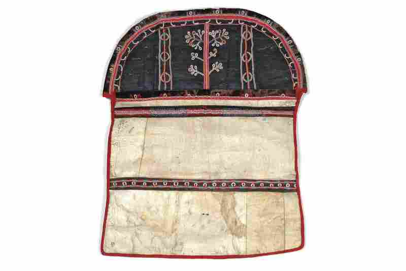 Sugpiaq sewing bag. Sewing was an essential skill and one of a woman's most important assets for marriage. Women kept their sewing materials, including thread made of sinew, in pouches like this one made of bleached seal throats and painted skin with caribou-hair embroidery.