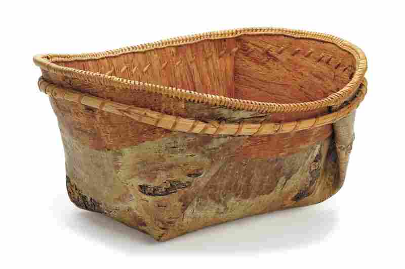 Athabascan basket. Baskets like this one made of birch bark and reinforced by a double rim of bentwood hoops were made to hold water and store foods such as berries, fish, oil and bear grease. Soups and stews were cooked in them by adding hot stones.
