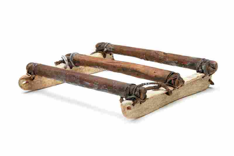 St. Lawrence Island Yupik boat sled. This small, traditional sled was for hauling hunting boats over sea ice to open water. This one is made of wood with walrus tusks for runners.