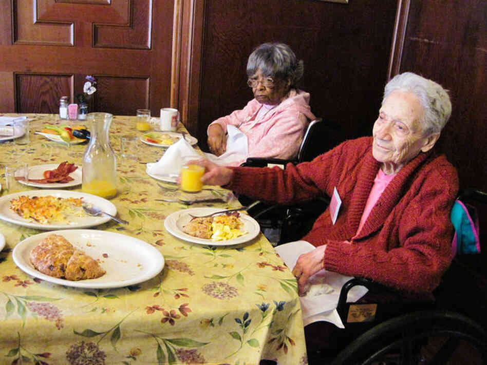 Genevia Samuel (left) and Mabel Weisenberger eat breakfast at a weekend camp for people with dementia, sponsored by the San Francisco Family Caregiver Alliance.