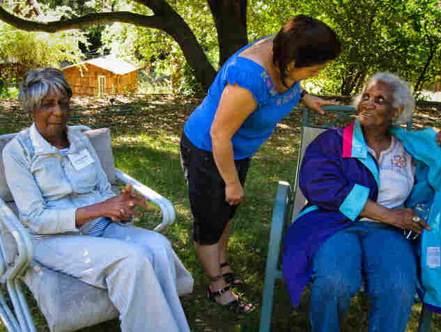 Nationally, about 5 million people have Alzheimer's and two-thirds are living with family members. Staff member Matilda Perez (center) chats with campers Amelia Parker (right) and Johnnye Jennings.