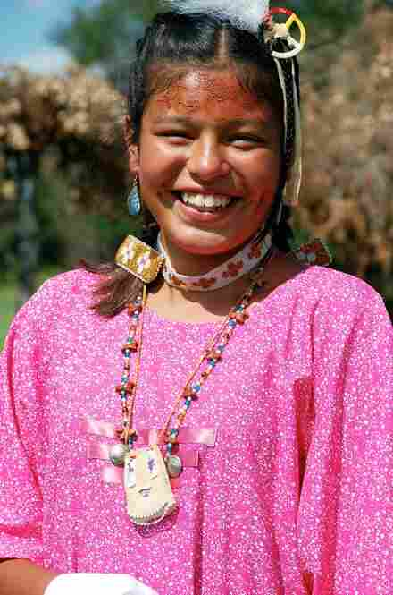 """Yasmeen Sandoval, 12, from Sioux City, S.D., wears a beaded leather medicine bag she made. The Indian name she was given at the ceremony translates as """"Good Talker Woman."""""""