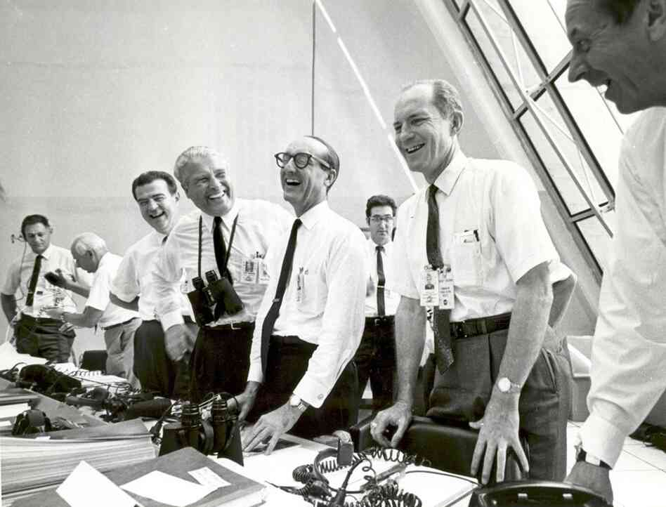 Apparently something hilarious had just happened at NASA. My imagination is running wild. A high five goes to whoever can come up with the best caption for this photo, taken just after the Apollo 11 launch, 1969.