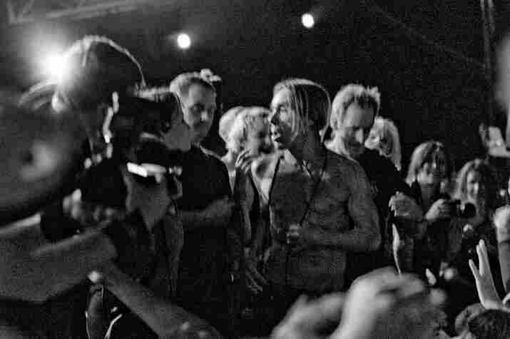 Iggy Pop invades the crowd.