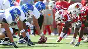 Kentucky and Louisville square off at the line of scrimmage.