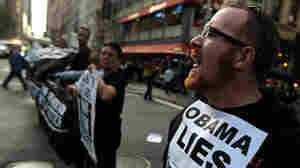 In New York on May 13, AIDS activists protested near a hotel when the president was visiting.