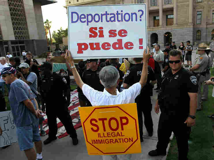 Arizona immigration law supporters and opponents rallied in Phoenix on July 31.