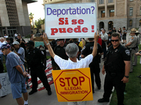 Supporters and opponents of Arizona's immigration law rallied in Phoenix on July 31. Many demonstrators carried signs to show their feelings.