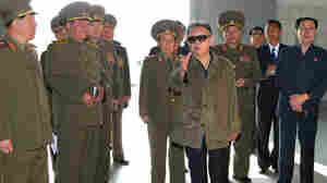 North Korean leader Kim Jong-Il (C) visiting the Taedonggang Combined Fruit Farm in Pyongyang.