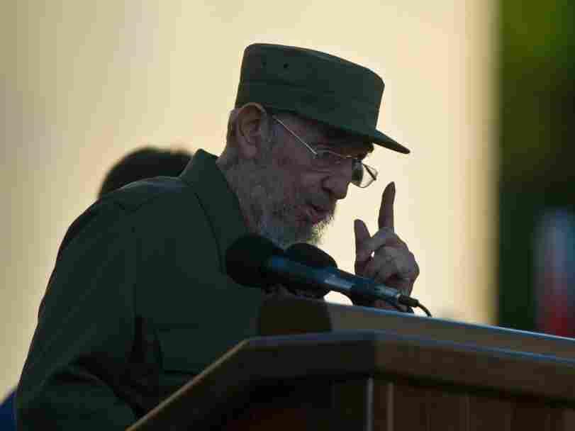 Cuban former President Fidel Castro give