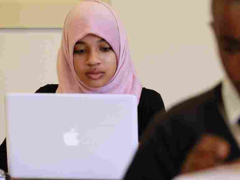 A young Muslim woman uses her computer.