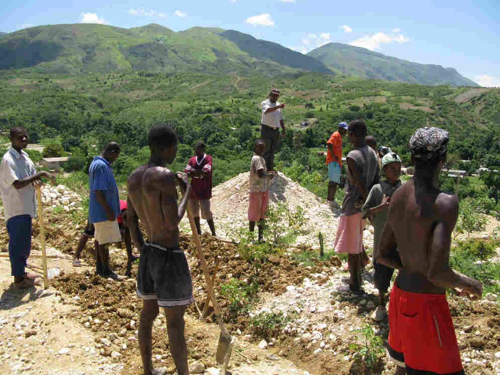 Digging up an old water line in Haiti.