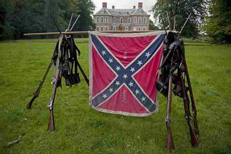 The Confederate flag and arms of the 18th Virginia Infantry stand in a field behind the stately Stanford Hall. The estate has been owned by descendants of 2nd Baronet Sir Roger Cave since construction began in the 1690s.
