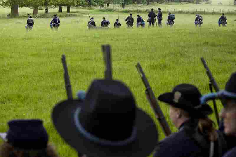 "Union re-enactors pause while making their way to a field to fight their ""enemy."""