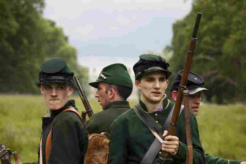 Members of the U.S. Sharpshooters band together during a private American Civil War Society battle at Stanford Hall in Leicestershire, England.